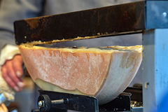 Traditional raclette swiss and french cheese Royalty Free Stock Image