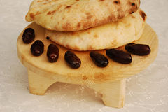 The traditional Ramadan meal: date palm and loaf royalty free stock image