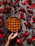 Traditional raspberry pie tart cake sweet baked pastry food on rustic table background. Autumn creative composition. Royalty Free Stock Photo