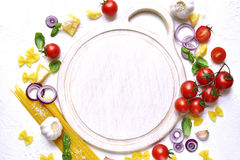 Traditional raw ingredients of mediterranean cuisine and empty cu Stock Image