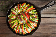 Traditional raw vegetable ratatouille in cast iron Stock Images