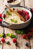 Traditional recipe for berry crumbble from currant berries, rasp. Berries and blueberries close-up in a saucepan on a table. vertical Stock Photos