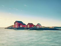 Free Traditional Red And White Houses In Small Fishing Village. Silent Bay In Spring Norway Royalty Free Stock Photos - 109653668