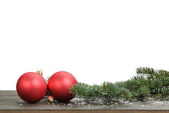 Traditional red balls and fir branch with fake snow. White background Royalty Free Stock Photo