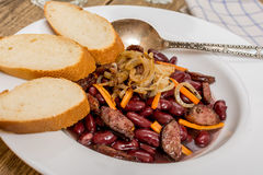 Traditional red beans. With sausage and vegetables and baquette Royalty Free Stock Photos