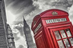 Traditional red british telephone Booth with Big Ben in London,. View of a traditional red phone booth with big ben at london in black and white colors. ideal Stock Images