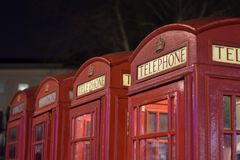 Traditional red British telephone booth in London royalty free stock photo