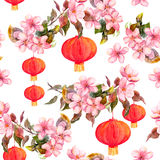 Traditional red chinese lantern in spring pink flowers - apple, plum, cherry, sakura. Seamless pattern. Watercolor. Art royalty free illustration