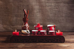 Traditional red chinese tea set, red porcelain with traditioanl chinese theatre masks Royalty Free Stock Images