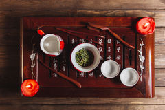 Traditional red chinese tea set, red porcelain with traditioanl chinese theatre masks Royalty Free Stock Image