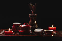 Traditional red chinese tea set, red porcelain with traditioanl chinese theatre masks Royalty Free Stock Photo