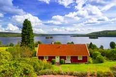 Traditional red cottage house in Sweden. Traditional red cottage house at the lake in Sweden Stock Photography