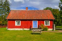 Traditional red cottage house in Sweden. Traditional red architecture of wooden cottage house in Sweden Royalty Free Stock Photography