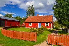 Traditional red cottage house in Sweden. Traditional red architecture of wooden cottage house in Sweden Royalty Free Stock Image