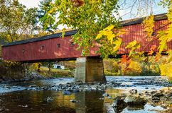 Traditional Red Covered Bridge in Autumn royalty free stock photography