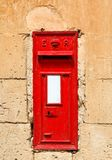 Traditional red English letterbox Stock Photo