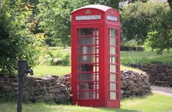 Traditional red English phone box ina country lane stock image