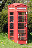 Traditional red English telephone box Stock Image