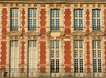 Traditional red facade. In the Place des Vosges, Paris royalty free stock photos