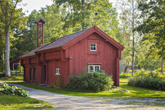 Traditional red farmhouse Stock Photography