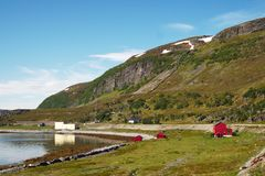 Traditional red fisherman shelter near the shore in Norway. stock photos