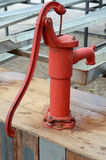 Traditional red Iron water pump Stock Photo