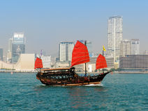Traditional red junk boat in Hong Kong Stock Photos