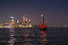 Traditional red junk boat in the Victoria Harbor in Hong Kong. At night - 2 stock images