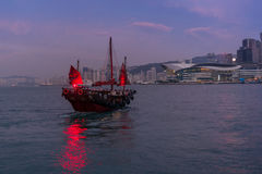 Traditional red junk boat in the Victoria Harbor in Hong Kong. At sunset - 2 royalty free stock photography