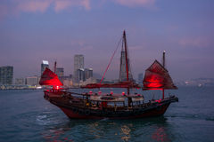 Traditional red junk boat in the Victoria Harbor in Hong Kong. At sunset - 1 stock photography