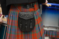 Traditional red kilt canteen on side. Background scottish kilt closeup canteen Royalty Free Stock Photos