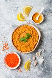 Traditional red lentil Dal. Indian Dhal spicy curry in bowl with flat bread and spices. Top view, overhead. Traditional red lentil Dal. Indian Dhal spicy curry Royalty Free Stock Photo