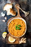 Traditional red lentil Dal. Indian Dhal spicy curry in bowl with flat bread and spices. Top view, overhead. Traditional red lentil Dal. Indian Dhal spicy curry Stock Images