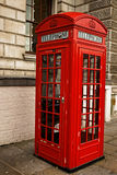 Traditional red London phone booth, London. Traditional red London phone booth, London, UK Royalty Free Stock Photography