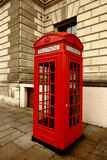 Traditional red London phone booth in London. Traditional red London phone booth, London, UK Stock Photography