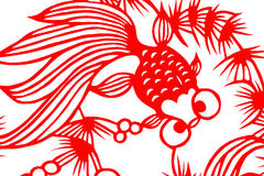 Traditional red paper cut fish. Traditional red paper-cut fish isolated against a white background Royalty Free Stock Images