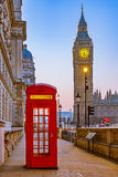 Traditional red phone booth in London. Traditional red phone booth and Big Ben in London Royalty Free Stock Image