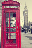 Traditional red phone booths in London with the Big Ben in a des Royalty Free Stock Image