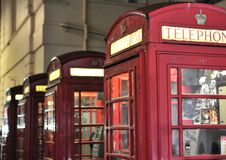 Red phone booths at night. 4 traditional red phone booths in London England Stock Photography