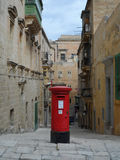 Traditional Red Post Box in Narrow Street in Malta Stock Photography