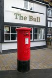 Traditional Red Post Box outside a Public House in England Stock Image