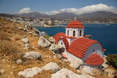 Traditional red roof church on Karpathos island, Greece. View of traditional red roof church on Karpathos island, Greece royalty free stock images