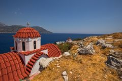 Traditional red roof church on Karpathos island, Greece. View of traditional red roof church on Karpathos island, Greece stock image