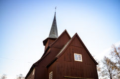 Traditional red stave church and blue sky Royalty Free Stock Photos