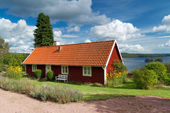 Traditional red Swedish cottage house Royalty Free Stock Images