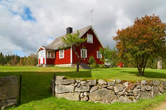 Traditional red Swedish cottage house Stock Photos