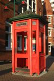 Traditional red telephone booth Stock Images