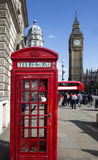 Traditional red telephone box in London public phone - a symbol Royalty Free Stock Photo