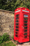 Traditional red telephone box in UK Stock Photo