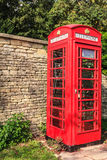 Traditional red telephone box in UK Royalty Free Stock Images
